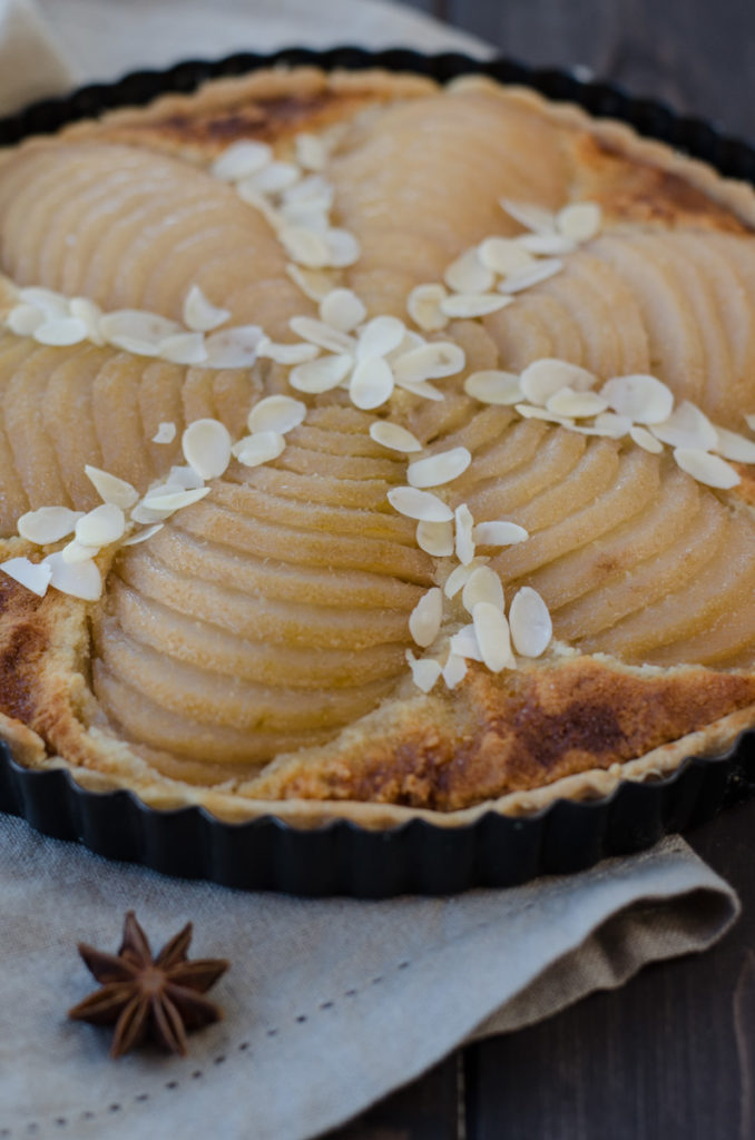 Gourmet Pear Tart with Almond Filling is great for these autumn days. Poached pears give the tart taste and smell of star anise, cinnamon and Calvados.