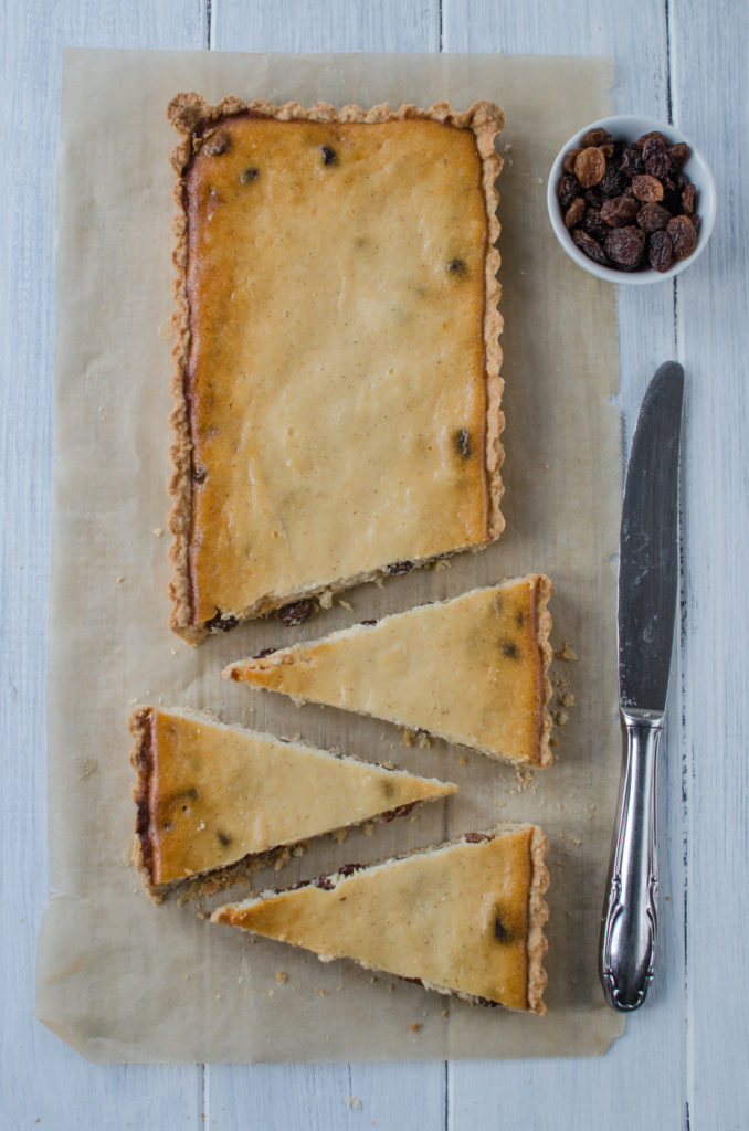 Italian Ricotta Tart is a Tart made of pate sablée filled with a mixture of ricotta, lemon zest, cinnamon and raisins soaked in rum.